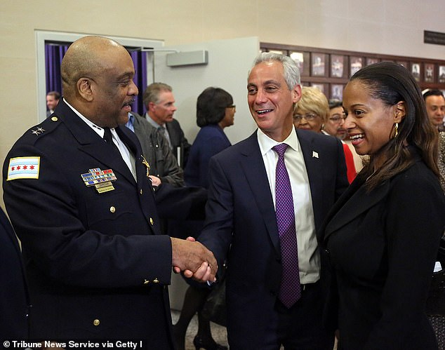 Johnson married his 43-year-old wife, junior officer Lt. Nakia Kenner (shown right), in 2017. The pair are pictured with former mayor Rahm Emanuel