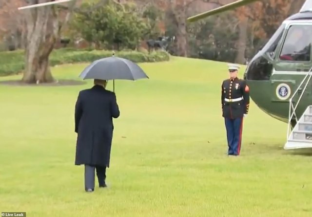 Forget something? Video from the couple's departure shows the President walking off towards Marine One, apparently unaware that his wife was not with him