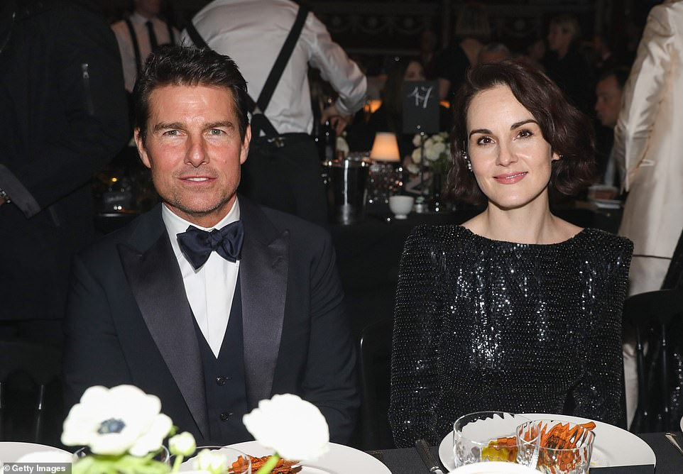 Good company: Inside the bash, she sat next to a dapper Tom Cruise as they enjoyed their luxury VIP dinner
