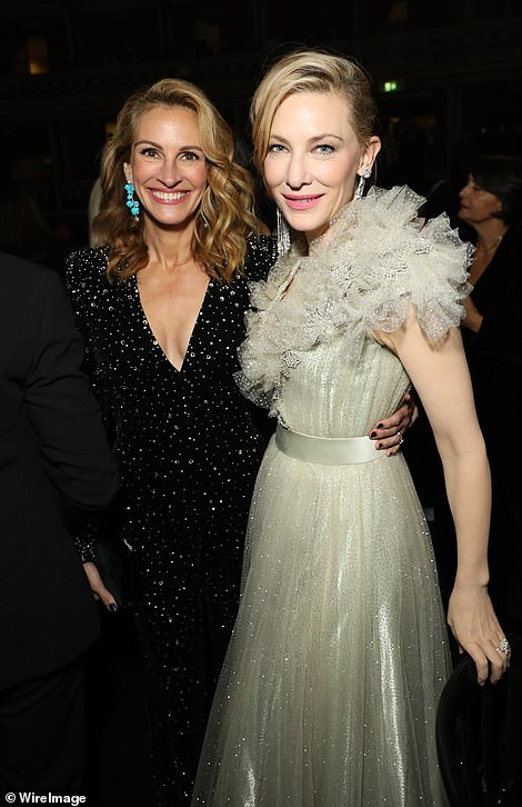 Pals: The screen stars looked in jovial spirits for the evening celebrating fashion