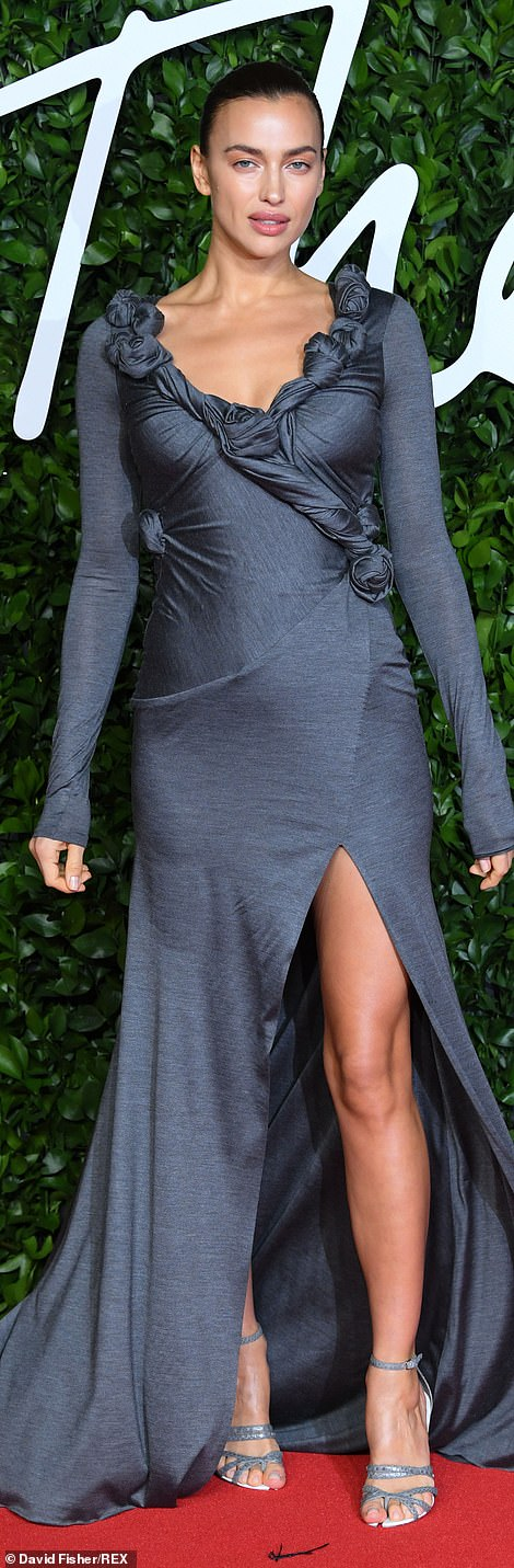 Runway: Irina Shayk, 33, stunned in a grey cut-out gown with hand-gathered details and grey snakeskin-effect leather block-heel sandals all by Burberry