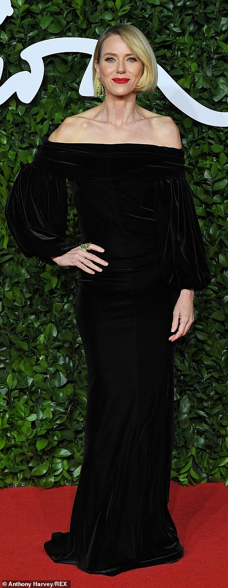 Watt about that: Naomi Watts wore a black velvet off-the-shoulder Burberry gown with puff sleeves and black satin peep-toe sandals