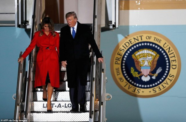 US President Donald Trump (R) and US First Lady Melania Trump disembark Air Force One after landing at Stansted Airport