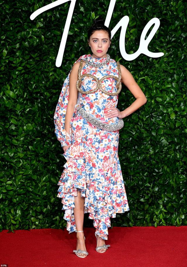 British actress Bel Powley, 27, (pictured) wore a confusing floral dress that had strange detail drawing attention to her chest and waist, certainly making a sartorial statement