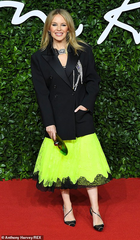 Kylie Minogue (pictured) seemed to have thrown a tuxedo jacket onto a fluorescent skirt keep warm, however it made her overall look appear boxy