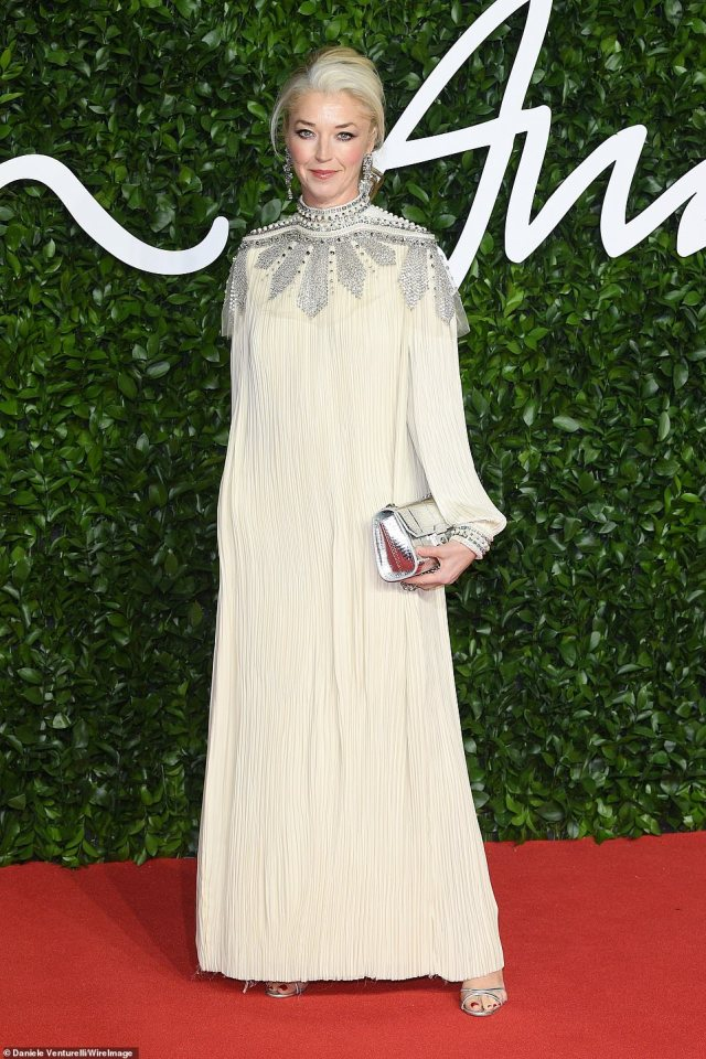 British socialiteTamara Beckwith, 49, (pictured) opted for a pleated cream dress with silver embellishment and clutch bag