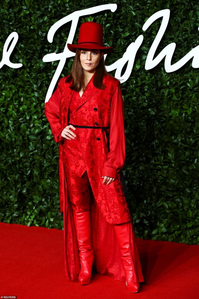 Swedish actress Noomi Rapace, 39, (pictured) who is best known forThe Girl With The Dragon Tattoo, donned a quirky head-to-toe red look for an eccentric display