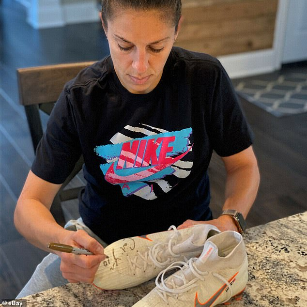 Going, going, gone! Soccer star Carli Lloyd signed a pair of cleats that shoppers can bit on starting today