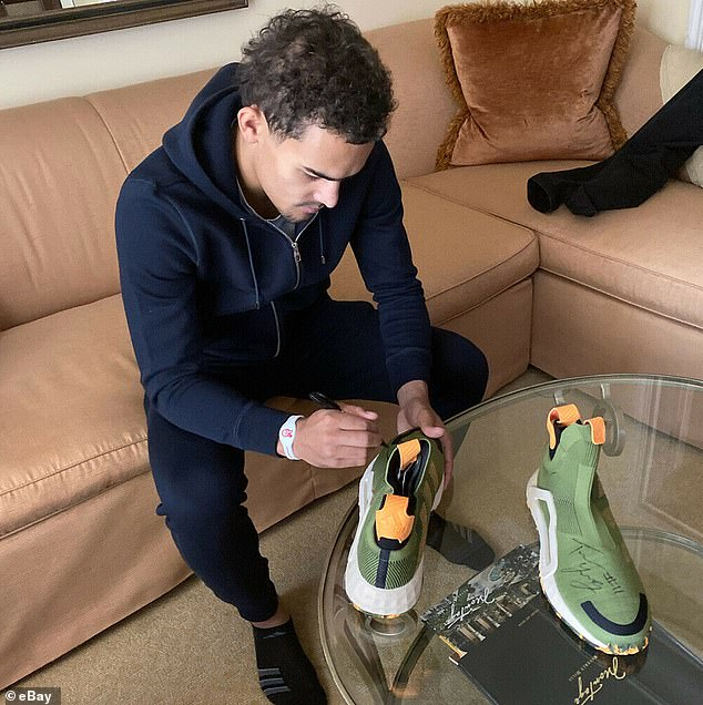 Putting his mark on them: Atlanta Hawks point guard Trae Young signed a pair of Adidas