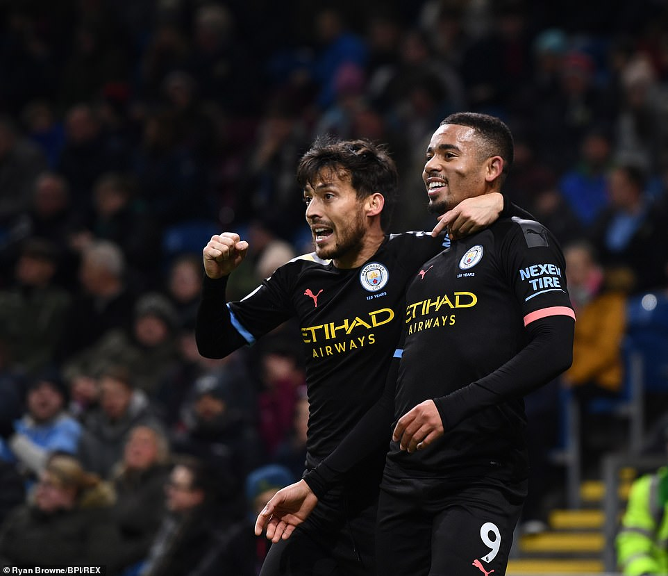 David Silva celebrates with Jesus after the Brazilian forward managed to break the deadlock at Turf Moor