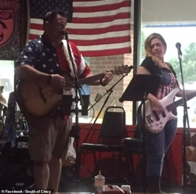 The judge hired her alleged lover, Stephen Penrose, who she is in a band with. They are shown during one of their country music band's gigs.