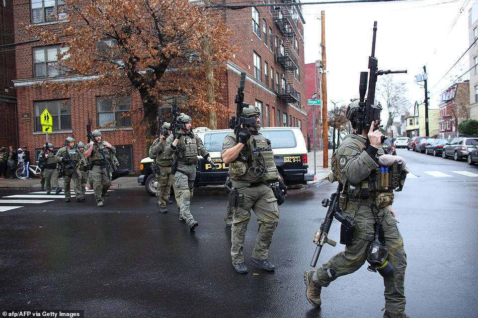 Six people have been killed in an hours-long shoot-out in Jersey City after a male and female suspect launched two-hour gun battle with a SWAT team that reportedly began in a cemetery and ended with them being shot inside a bodega