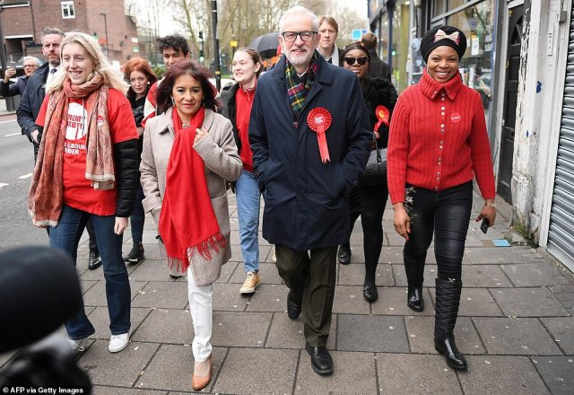 Labour leader Jeremy Corbyn and his wifeLaura Alvarez were joined by supporters as he came to vote in North Islington
