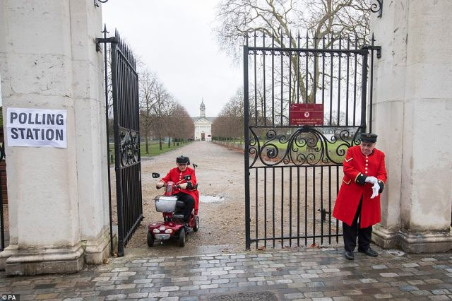 Chelsea Pensioners leave after casting their votes at the world famous Royal Hospital in west London