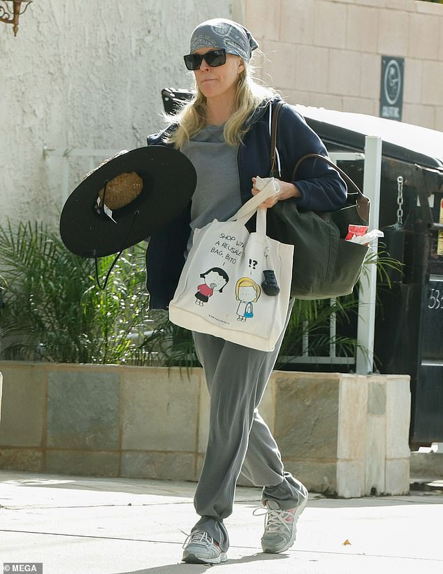 Chilled:Kim Basinger stepped back from the glitz and glamour to Hollywood as she cut a very casual figure as she left a Pilates Studio in Los Angeles, California on Wednesday