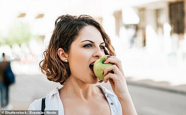 Experts believe a type of fibre found in apples fuels important gut bacteria to produce short-chain fatty acids which may lower the liver's production of cholesterol [File photo]