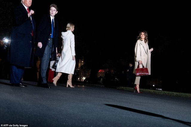 "22517168 7815917 The first lady far right flashes a smile as she and her family w a 32 1576890762759 The first family landed in their Mar-a-Lago residence in Palm Beach on Friday after departing the White House for the Christmas holiday. Barron Trump was photographed alongside his parents towering over his 6""2 father."