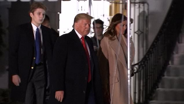"22518536 0 image a 14 1576892714484 The first family landed in their Mar-a-Lago residence in Palm Beach on Friday after departing the White House for the Christmas holiday. Barron Trump was photographed alongside his parents towering over his 6""2 father."