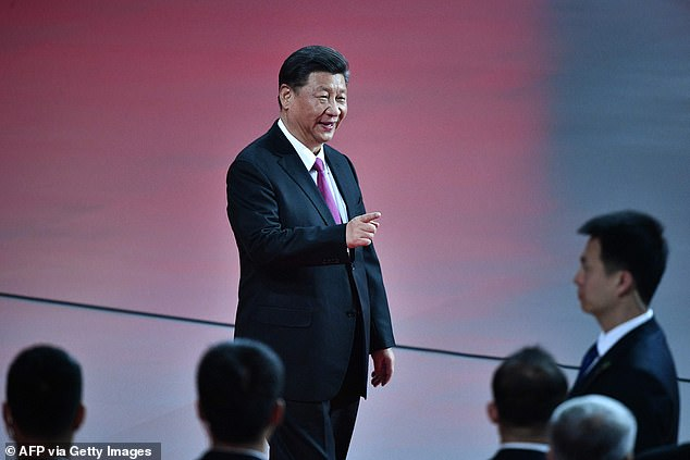 China's President Xi Jinping gestures as he attends a variety show in Macau earlier this month. A Chinese official stressed in November that religious authorities must follow President Xi's instructions and interpret the ideologies of different religions in accordance with 'the core values of Socialism' and 'the requirements of the era'