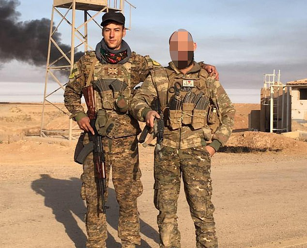 Front line: Dan Newey with a YPG comrade in 2017. His Kurdish-led military unit was backed by Britain and trained by the SAS