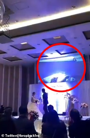 The lewd footage (circled) capture by a security camera was played out in front of the couple's family and friends, it is claimed