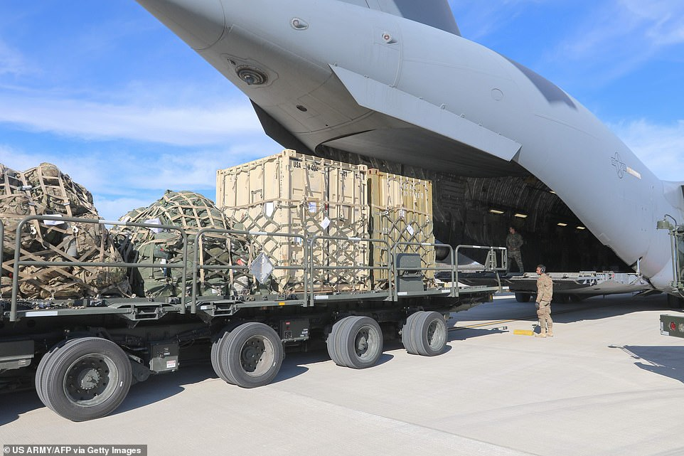 Airmen assigned to 43rd Air Mobility Operations Group conducting loading operations on C-17 Globemaster III aircraft