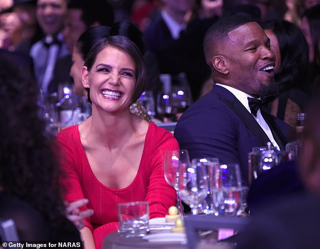 Spotted: Katie Holmes and Jamie Foxx attended the Clive Davis and Recording Academy Pre-GRAMMY Gala on January 27, 2018 in New York City appearing happy