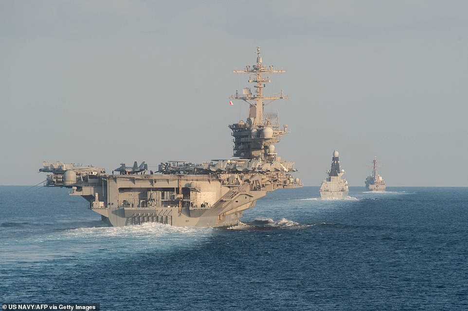 An Iranian official revealed that at least 35 US targets have been identified for retaliatory strikes, including ships in the Persian Gulf and the Strait of Hormuz. Pictured: The aircraft carrier USS Abraham Lincoln (L), the air-defense destroyer HMS Defender and the guided-missile destroyer USS Farragut transit the Strait of Hormuz in November