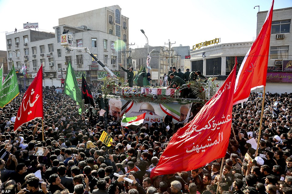 The flag-draped coffins of Gen Qassem Soleimani and his comrades who were killed in Iraq in a US drone strike, are carried on a truck surrounded by mourners during their funeral in southwestern city of Ahvaz, Iran, on Sunday