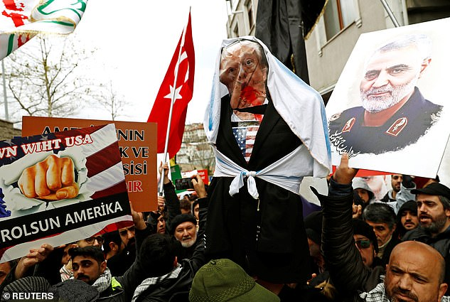 Demonstrators attend a protest against the killing of Iranian Major-General Qassem Soleimani, head of the elite Quds Force, who died in an air strike at Baghdad airport, outside the US Consulate in Istanbul, Turkey