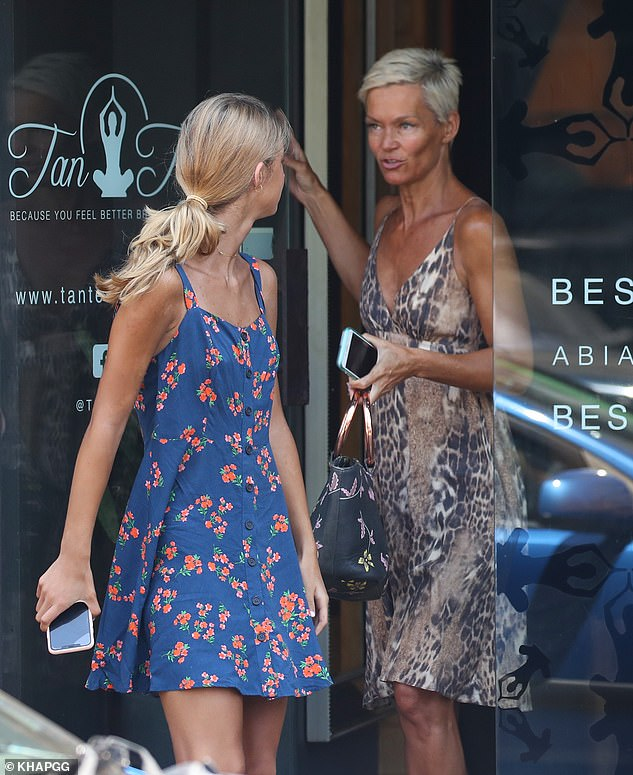 We've all been there! Jessica Rowe looked a deep shade of brown while leaving the Tan Temple salon in Bondi Beach on Saturday accompanied by her 10-year-old daughter, Giselle