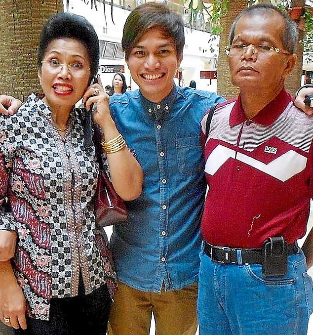 Privileged: Sinaga  (centre) with his property tycoon father Saibun (right) and mother Normawaty (left)