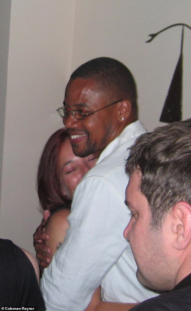 Gooding is seen kissing and hugging a mystery woman at a private party during the Cannes Film festival in 2004