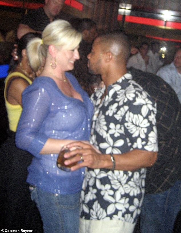 Another photo from the same night out in the Bahamas in 2008 shows Gooding schmoozing with a third woman