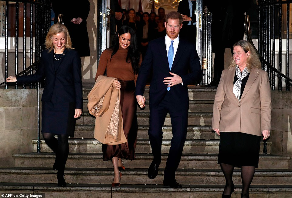 The Duke and Duchess of Sussex leave holding hands after visiting Canada House in London yesterday afternoon in London