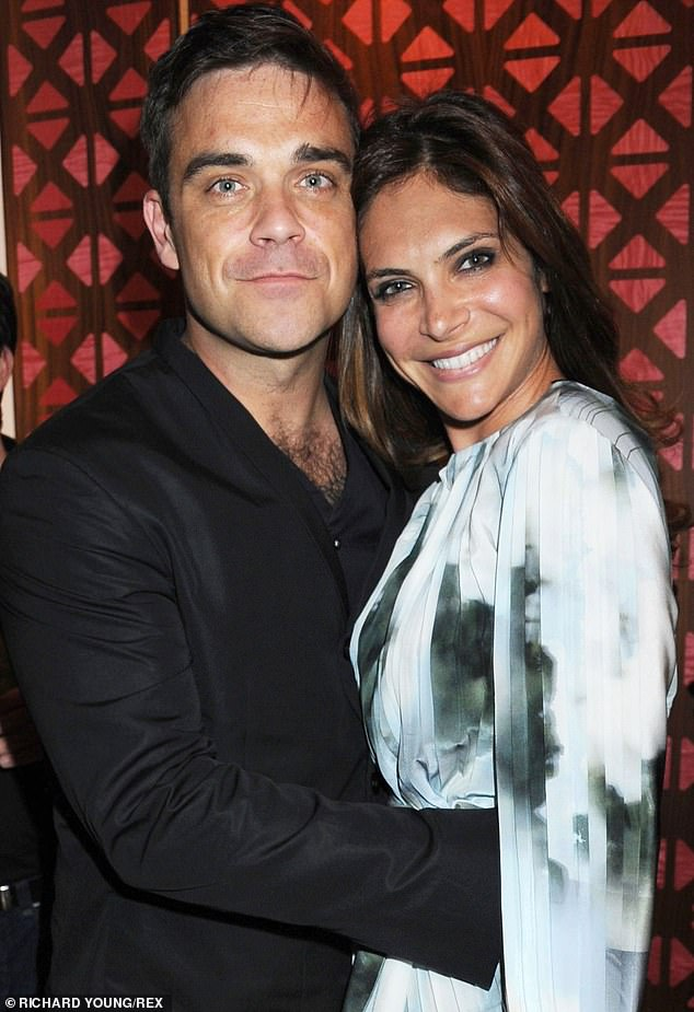 Famous friends: The instructor was reportedly introduced to Adele through Robbie Williams' wife Ayda (right) and even gave them a joint workout in the Angels singer's LA mansion