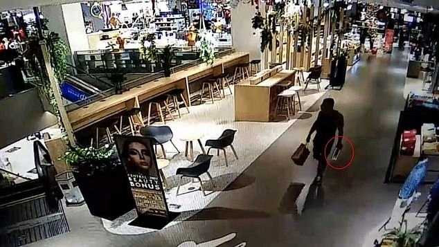 Depp (right) was captured on CCTV at the Central Floresta shopping mall on December 26 leaving the store with the drone (circled) without allegedly paying it.