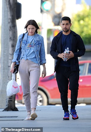 Wilmer sported black sweats and a matching jacket, adding a blue shirt and colorful sneakers