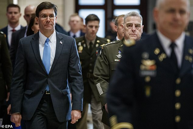 Secretary of Defense Mark Esper (left) and Chairman of the Joint Chiefs of Staff Mark Milley (right) arrive to brief lawmakers