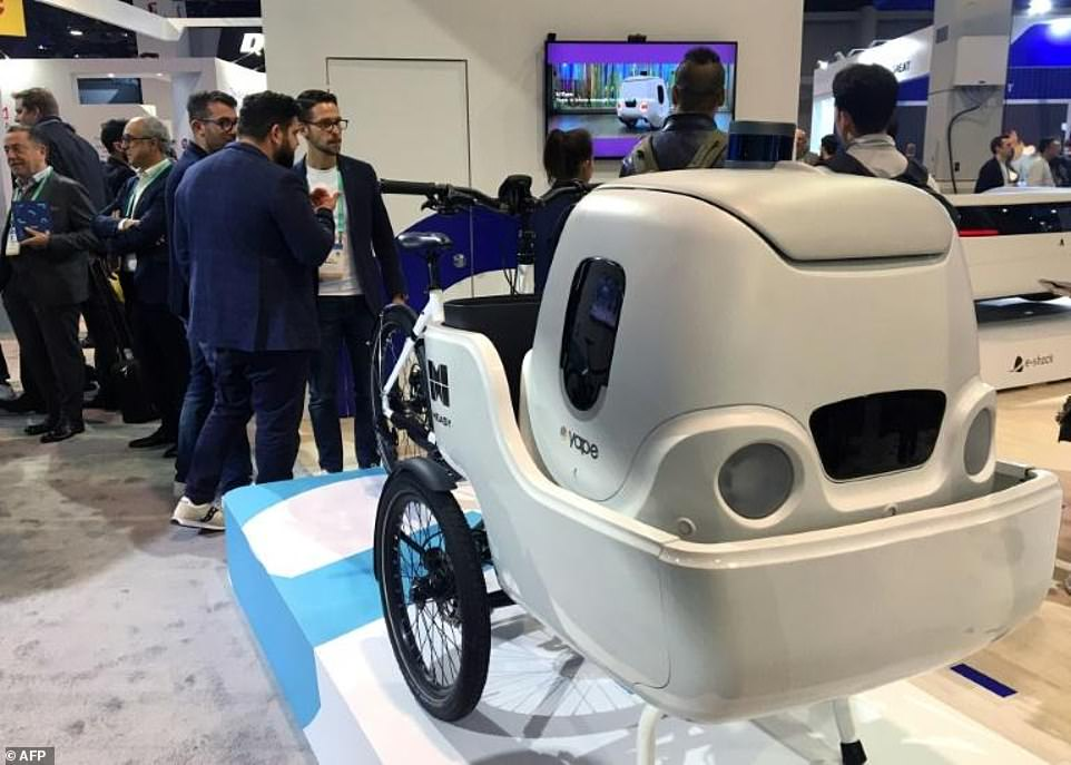 An electric cargo bike from Italian startup Measy uses a delivery robot from sister company Yape for multimodal transportation at the 2020 Consumer Electronics Show