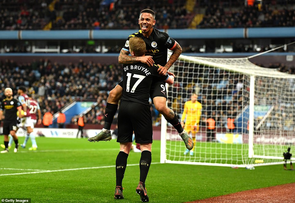 Jesus celebrates with De Bruyne as the rampant visitors inflict a heavy defeat on Aston Villa and manager Dean Smith