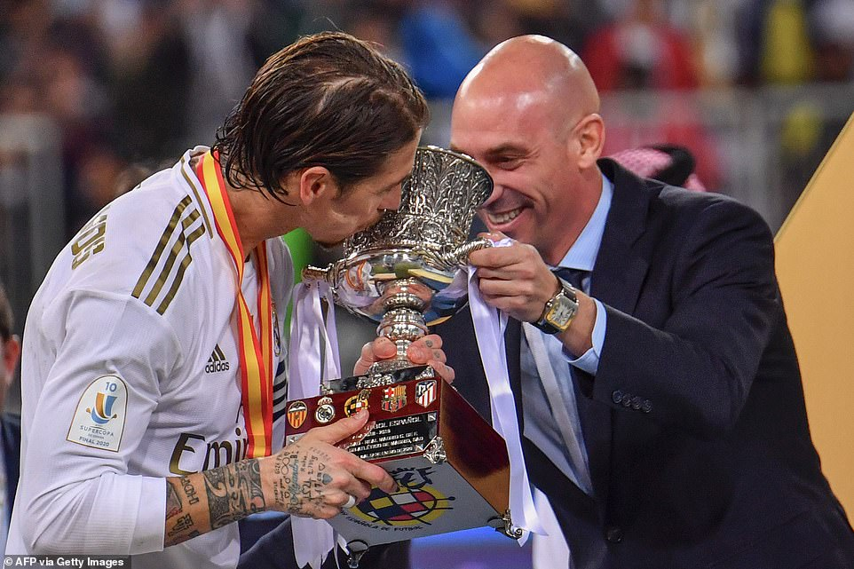 Los Blancos defender Sergio Ramos kisses the Spanish Super Cup trophy after canceling the decisive penalty in the shootout