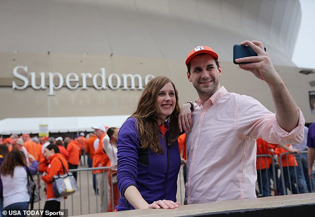 Clemson fans Brandon Large and Kristen Clevenger pose for a selfie outside the Superdome