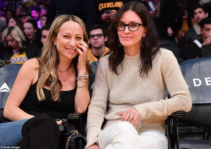 Watching all the sporting action: The duo enjoyed an unbeatable view with their courtside seats