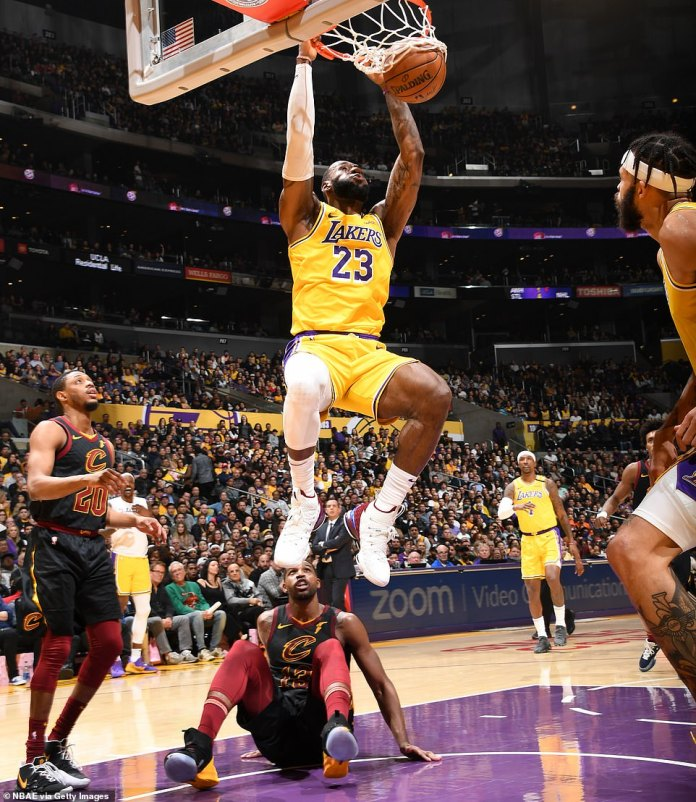 Khloe's ex: Tristan Thompson (pictured on the floor) was playing for theCleveland Cavaliers while LeBron James (pictured mid-slam dunk) was on the court for the Lakers