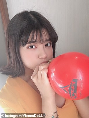 Pictured: Vienna blows up a red Pixar balloon