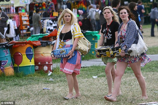 Council bosses have warned Glastonbury Festival it may limit the amount of alcohol people can take in. Pictured: A group of young women carry beer at the festival held in Somerset last year