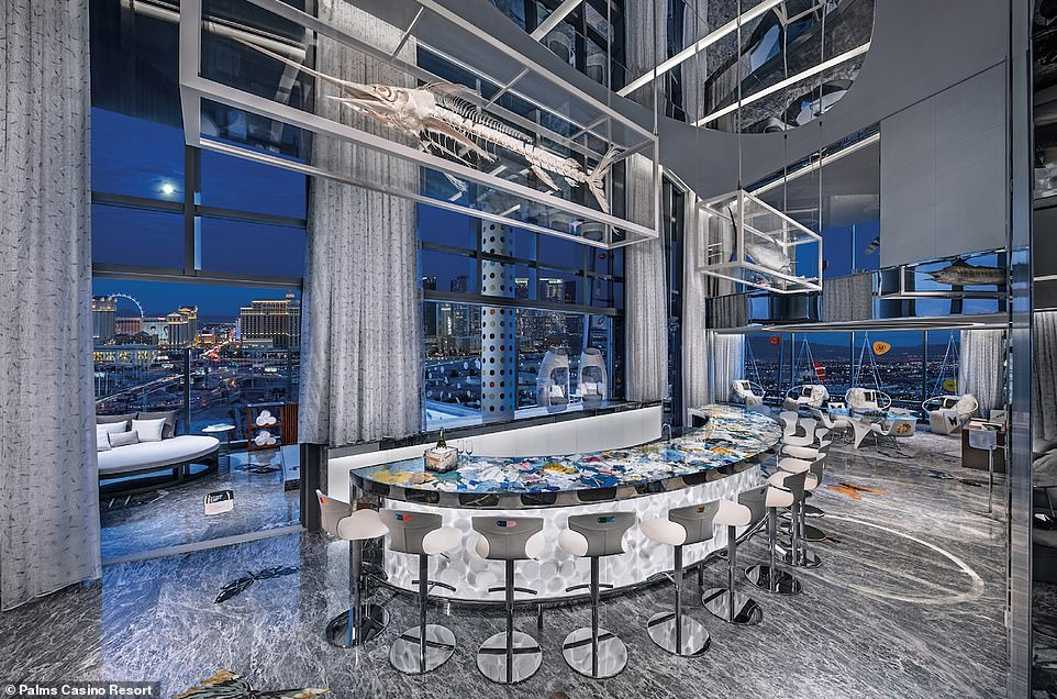 Inside the two-bedroom Empathy Suite at the Palms Casino Resort, Las Vegas, where a minimum two-night stay costs $200,000 (£154,000). It is the most expensive suite on the list with Elite Traveler describing it as 'an adult¿s playground'