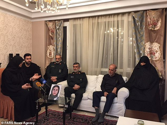 Most of those on board the plane were Iranian or Canadian-Iranian (pictured:Commander Amir Ali Hajizadeh meets with a victim's family)