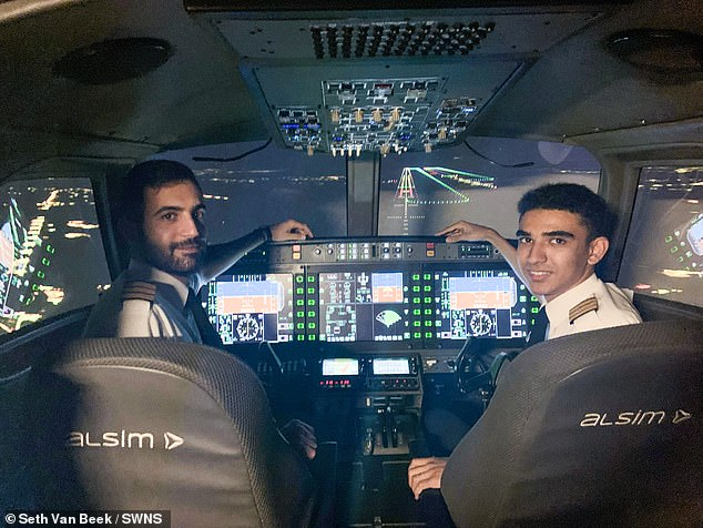 The teenager received his licence to fly passenger planes in October after completing nearly 18 months of training. Pictured: Seth with a colleague in a flight simulator